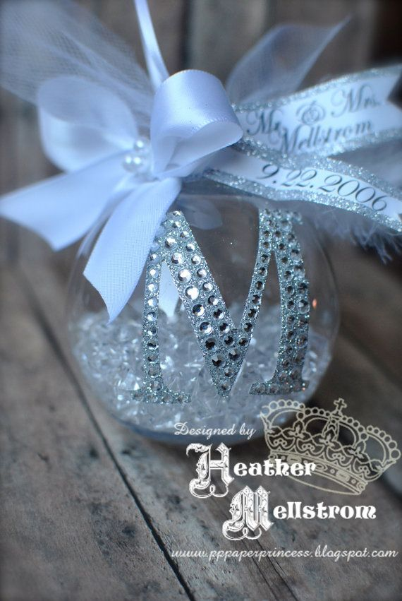 This would make a great 1st christmas ornament after the wedding. I would use leftover bling we had from the table scatter inside. Rhinestone Monogram Christmas by PaperPrincessStudios on Etsy