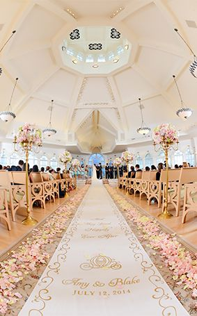 Light pink and ivory rose petals lined the aisle at Amy & Blake's Walt Disney World wedding
