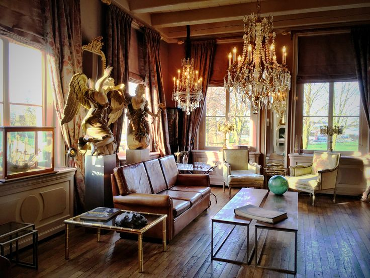 Living room, antique and vintage, chandeliers, carved angel sculptures, old wooden floor boards, cognaq leather couch, interior
