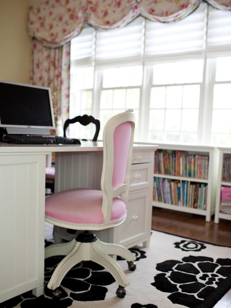 This floral-themed home office features a black and white floral area rug and pink floral curtains as well as a pink office chair, making it perfect for a tween girl's study area.