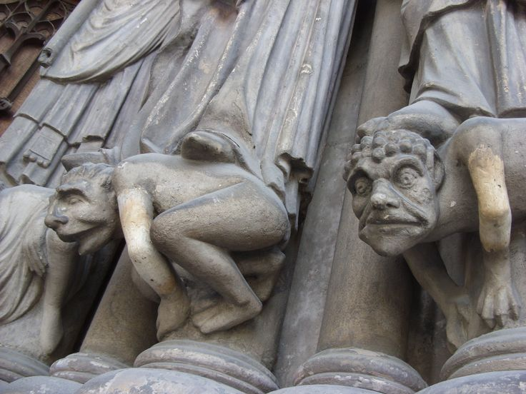 Little gargoyle dudes, exterior of the Cathedral of St. Denis, just outside of Paris. 2012. M. Santangelo