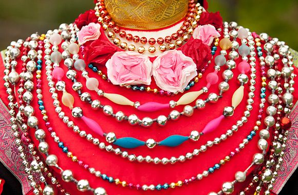 The front of the dress is covered by a red collar with hundreds of glass pearls and beads. This type of beads are not unlike the beads we use today decorating our Christmas tree.