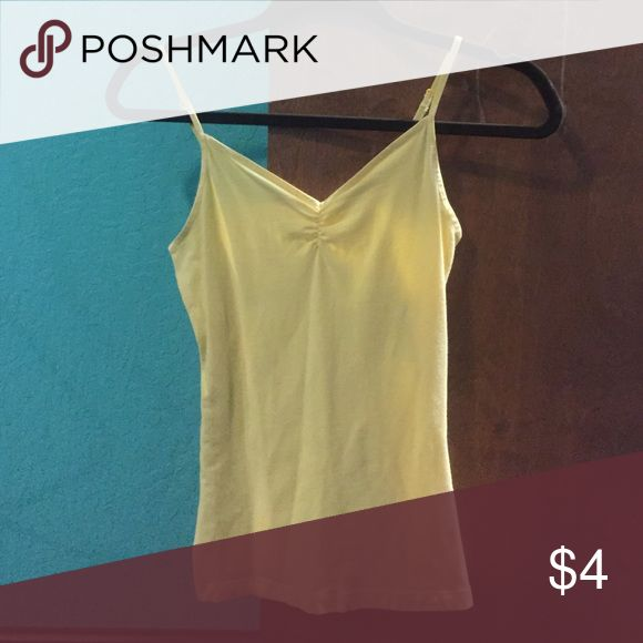 Yellow tank top This is a bright yellow tank top from wet seal. Size M. Wet Seal Tops Tank Tops
