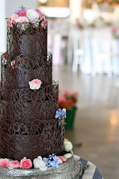 Chocolate Cake by The Hunt House Kitchen. Artistic lattice/cage work in chocolate adds layers with simple flower work