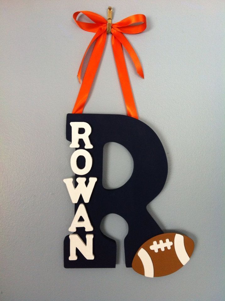 Personalized Boy Wood Letter and Name with Ribbon - Hanging Nursery Decoration - Wall or Door Decoration This adorable hand painted wooden name and letter decoration if the perfect addition to any nursery or kids room. Makes an excellent baby gift! All of the letters are made of wood (as is the football decoration). The large letter is 9 inches tall and features a key hole at the back for easy and secure hanging. Each big letter supports up to 6 small letters for the name. EVERYTHING IS…