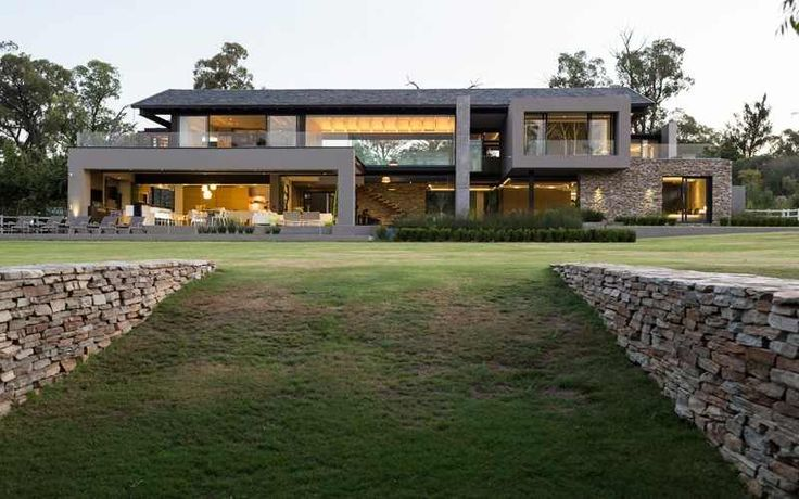 House in Blair Atholl by Nico van der Meulen Architects is a luxury farmhouse located between Pretoria and Johannesburg, South Africa, in a secluded golf estate. Free from high boundary walls and elec