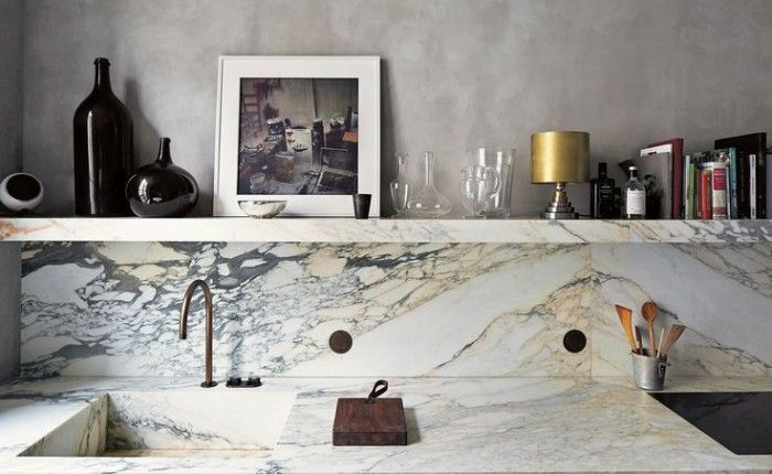 marble backsplash, sink and shelves in kitchen