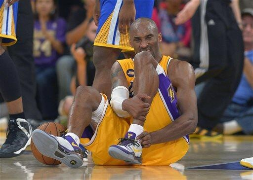 Kobe Bryant grabs his ankle after his probable Achilles Heel injury