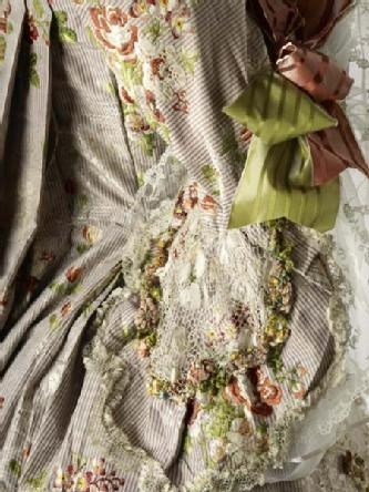 Sleeve detail, Robe a la francaise, 1762-1767. This gown is made of a very thin silk or taffeta with very fine stripes of red, blue and white, which, seen from afar, give the impression of mauve. A white leaf pattern is woven into the fabric and as well as floral sprays in various colours.