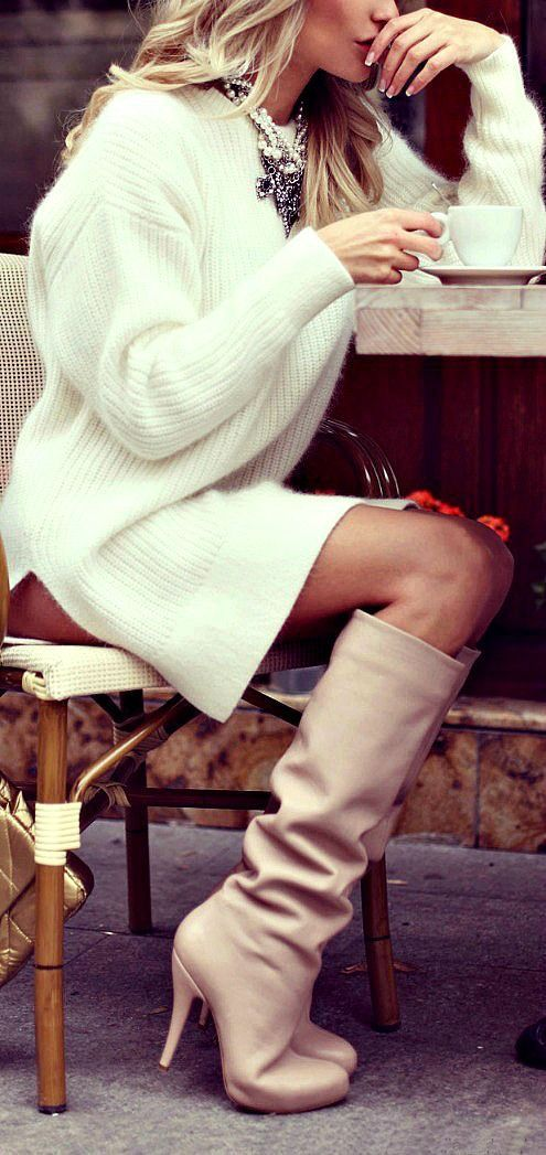 cream-colored chunky, mid-level, long sleeve sweater dress. matched with light tan, leather, slouchy, knee-high boots.