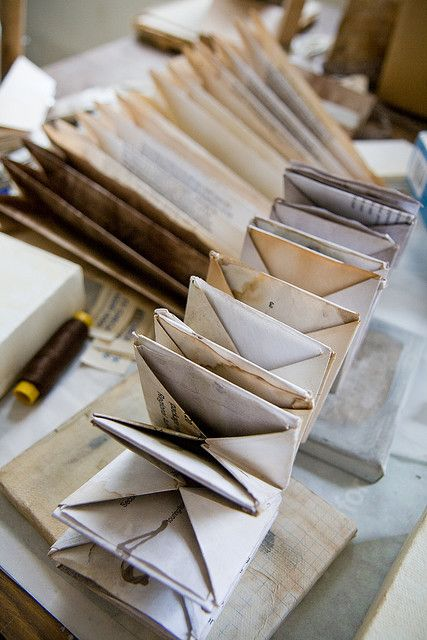 Jade Pegler handmade book - a new kind of book; i figured out i could join pieces of paper together to make a book without adhesive, or stitching, using a particular method of folding.  #paper_folding #paper_arts