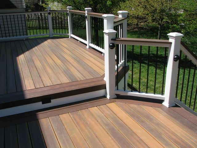 This multilevel low maintenance deck is in Ashburn, Virginia. We used Fiberon Ipe decking with a Fiberon Rosewood two board border. The railing is the Trex Transcend railing with aluminum balusters, low voltage rail lights and vinyl lattice skirt.