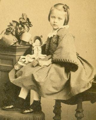 """Little girl, identified as """"Louisa"""" and dated 1863, with her doll. Great CDV photo from the Civil War years."""