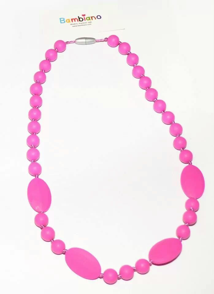 Bambiano Eliza Necklace in Hot Pink. Bambiano Necklaces are made of 100% Food grade silicone. BPA free, Lead free and nontoxic. Fashionable for Mums and safe for teething babies to chew on. Pendants are washable and soft on baby's gums. Shop at www.bambiano.com