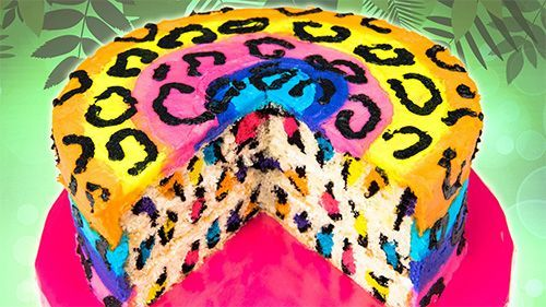 Rainbow Leopard Cake Ingredients: • 6 cups vanilla cake batter • 6 cups vanilla buttercream • Gel paste (deep pink, sky blue, yellow, orange, purple, black)