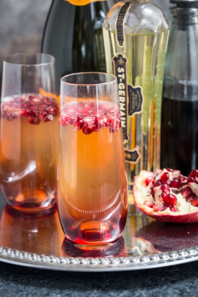 St. Germain and Pomegranate Champagne Cocktail is just what you need to ring in the new year. Just a few ingredients, and you're all set!