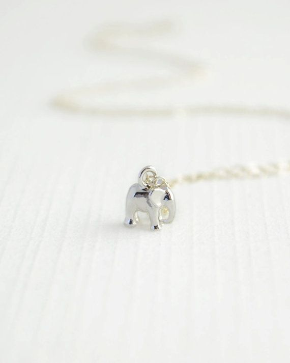 Olive Yew's tiny elephant charm bracelet is certain to bring you good luck! Available in silver or gold.