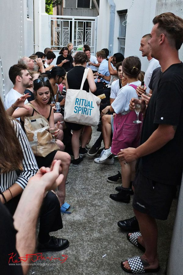 Outside Arbiters at KUDOS Gallery photographed by Kent Johnson for Street Fashion Sydney.