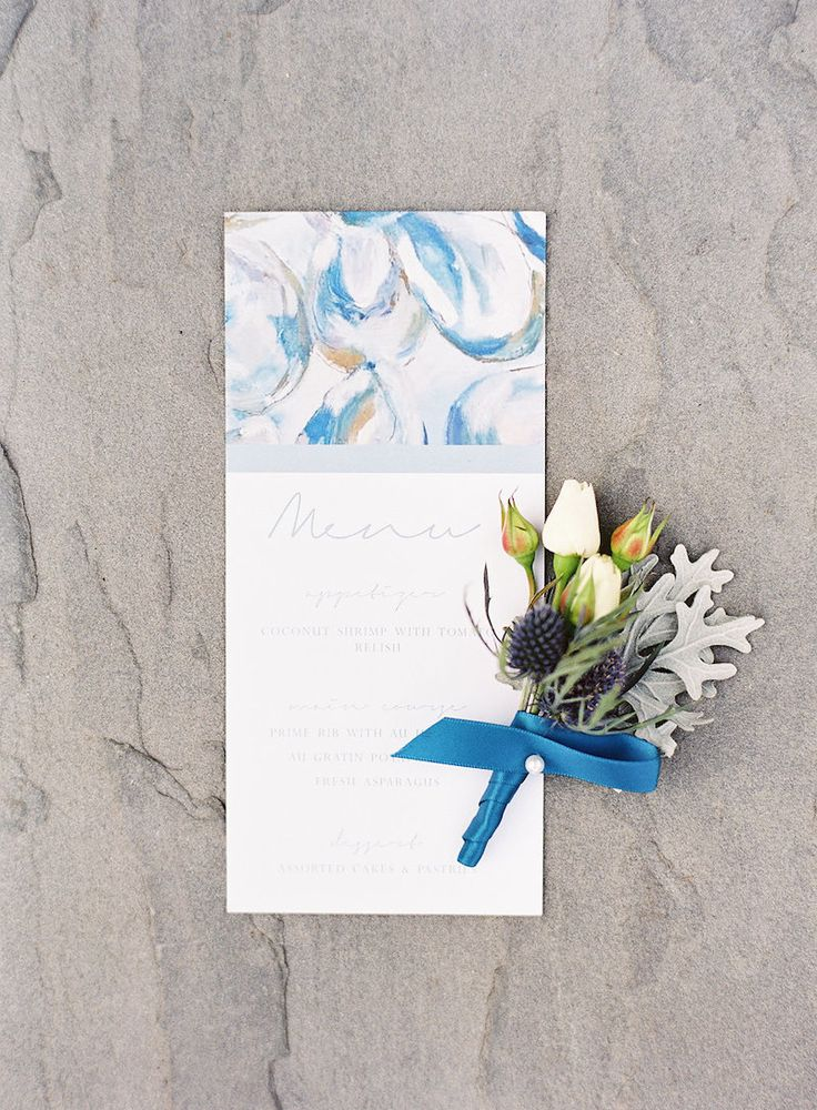 Marbled wedding dinner menu and boutonniere