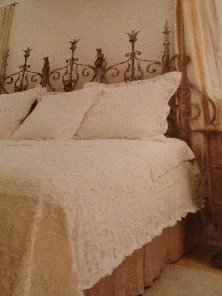 Antique French iron gate salvaged in Paris as a headboard