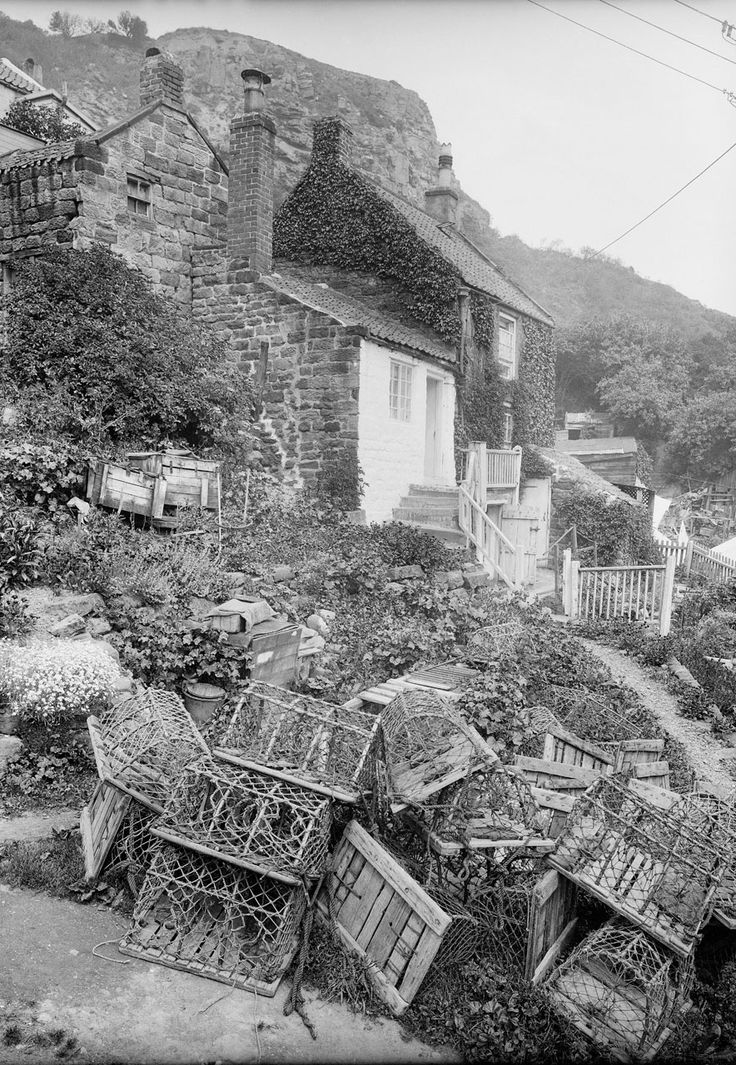 Fishermans cottage with lobster pots, Runswick Bay, Yorkshire - National Maritime Museum