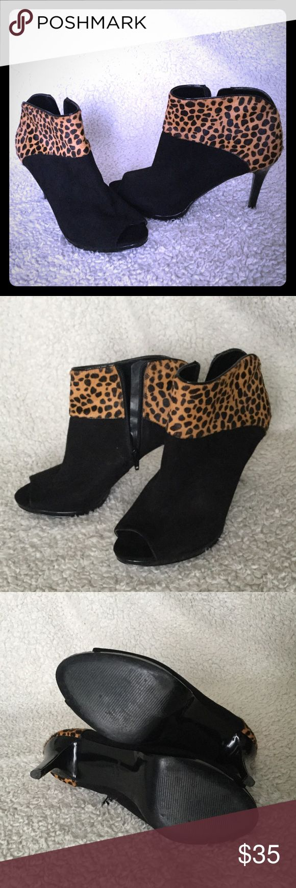 Black Suede and Leopard Fur Nine West Bootie Suede and Fur Bootie. Peep toe. Slight platform.  Inside zip. Slight scuff on inside of one shoe, see pic. Not noticeable when wearing. Otherwise in excellent shape, worn twice for speaking on stage. Nine West Shoes Ankle Boots & Booties