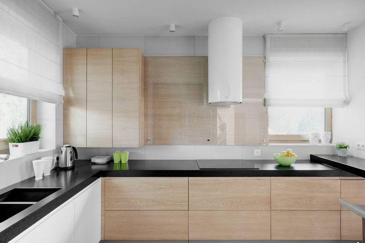 Wooden Drawers and White Cabinets under the Black Countertop