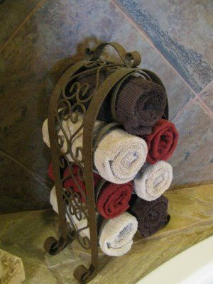 Wine Rack as Towel Rack. You could do this with taller racks and use shower towels not just hand towls... hmm great idea for apartment bathroom? I think yes