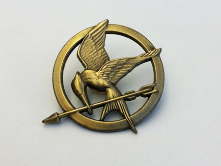 Got 2 things today:  1. This mockingjay pin  2. Tickets to see the hunger games on March 23rd! Unfortunately all the midnight premiere tickets sold out near me :'( oh well, I'm sure it'll be just as crazy and fun!