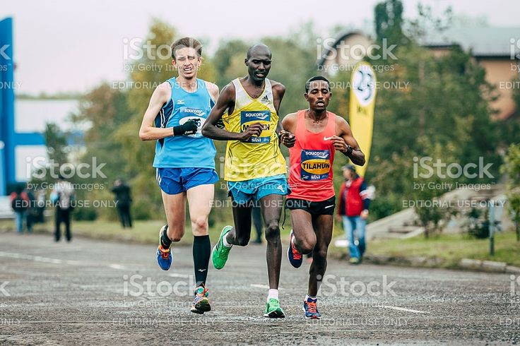Omsk, Russia -  September 20, 2015: Kenyan Laban Kipkemoi Moiben leading the race during Siberian international marathon