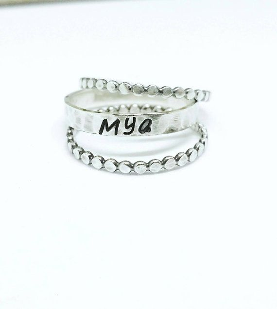Check out this item in my Etsy shop https://www.etsy.com/ca/listing/488797944/name-stacking-rings-set-of-3-name-rings
