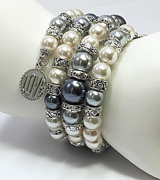 You will enjoy years of compliments with this memory wire bracelet. This stunning chunky bracelet blends striking beige Swarovski beads and gray glass pearl beads with silvertone spacer beads and love charms. Bead size range from 3mm to 10mm. This silver wrap bracelet would pair