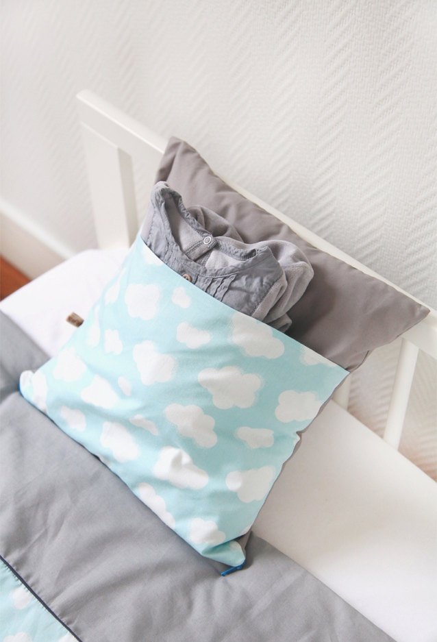 Pillow with a pocket  -  'Nuages' via Etsy.