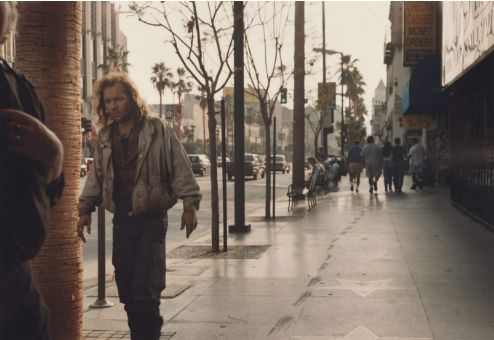 """Philip-Lorca diCorcia: Los Angeles. It is the ideas in this image that I found particularly inspiring. For me the first feature of the image I notice is the man in the foreground who seems un-kept and could possibly be homeless. Then I notice that there are the Hollywood stars on the ground. To me this shows a side of LA that isn't the one that is advertised, it like the image is showing the """"real"""" LA, that it isn't just famous people that walk down these streets, real people do as well."""