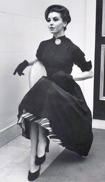 "Adore her whole ensemble! (1951) #vintage #1950s #fashion #dresses -love the striped ""hem"". Is that a crinoline, or under hem ? Imagine in lovely satin striped material...great eye-catcher. Matching trim on glove cuff would be stunning."