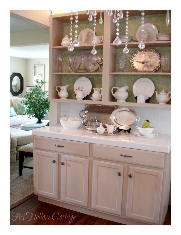 Kitchen open cabinets with nautical charts