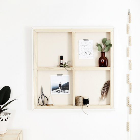Turn an old canvas into a small shelf or mood board!