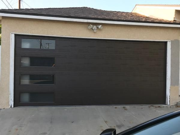 Mundo Flush Panel Steel With A Natural Wood Grain Texture Garage Door And Vertical Windows Garage Door Design Garage Door Styles Modern Garage Doors
