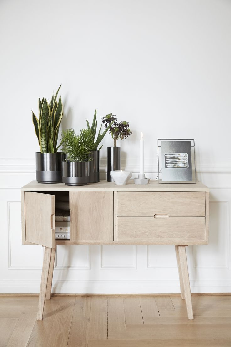 The Beauty Of Simplicity Our New Oak Dresser Has A Simple Design Here Styled With Cool Metal Pots And Vases