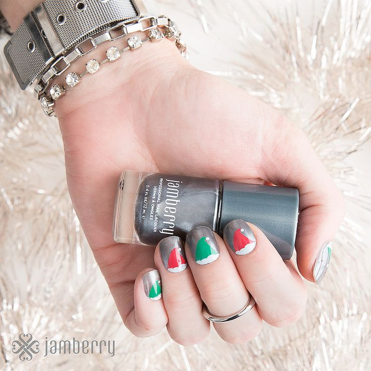 Jamberry Nails Christmas Elves over Gun Metal lacquer.   https://sharlaschoen.jamberry.com/us/en/shop/profile#.VkzFwl9OLCQ