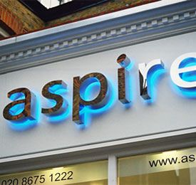 Individual chrome letters with blue halo illumination