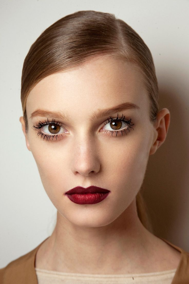 Lips & Lashes | Fresh complexion paired with layered mascara and a crisp red lip