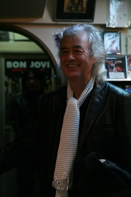 Jimmy Page of Led Zeppelin spotted in a record store with one of his famous scarfs