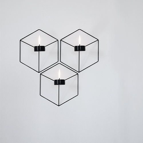 I think these wallmounted candle holders are pretty and stylish. Love geometric shapes!