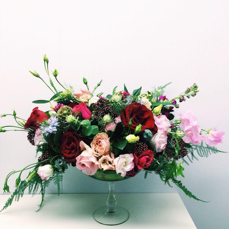 Deep red flower arrangement: roses, sweet peas, nigella, carnation, lisianthus