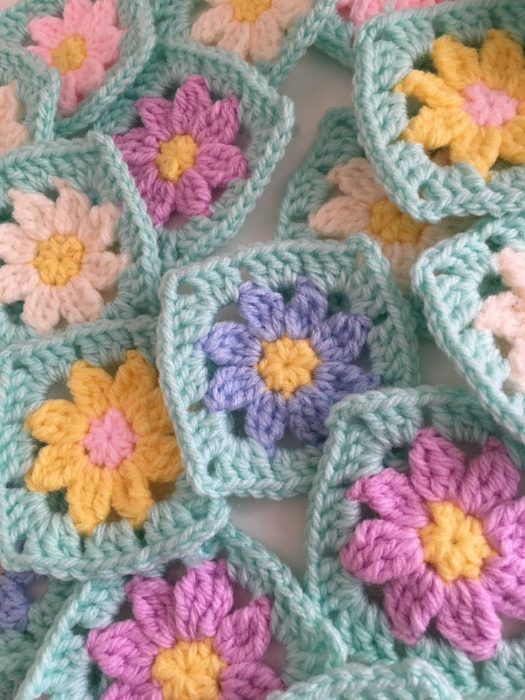 A personal favourite from my Etsy shop https://www.etsy.com/uk/listing/576381610/30-granny-squares-crochet-flower-centre