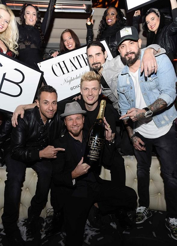 The Backstreet Boys Host After-Party at Chateau Nightclub & Rooftop in Las Vegas (Pictured: Howie Dorough, Brian Littrell, Nick Carter, Kevin Richardson and AJ McLean with Engraved Moet Bottle – Photo credit: Bryan Steffy /WireImage).