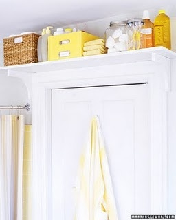 add a bookshelf above your bathroom door, to keep all your extras!