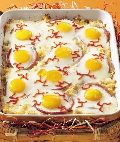 baked eyeball eggs add a gory halloween effect to breakfast with this creamy baked bacon eggs and potatoes eyeballs dish - Gory Halloween Food Ideas