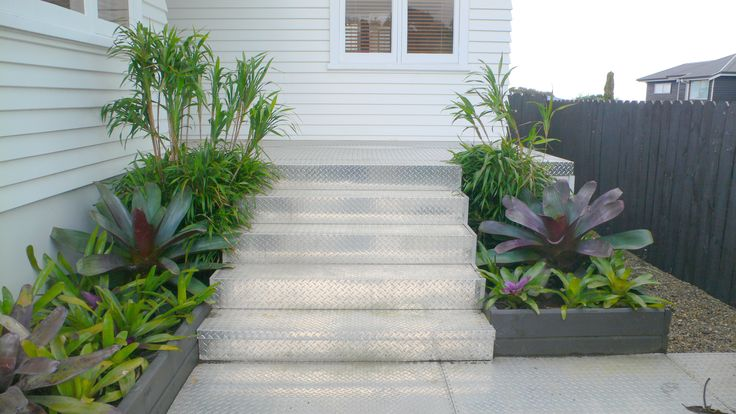 The front entrance to Fusion Landscape Designs office. We used industrial checker plate to provide a funky non slip surface. www.fusionlandscapedesign.co.nz